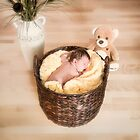Sleeping Newborn in Basket by Yannik Hay