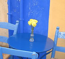 Blue chairs and tables by Francesca Muir