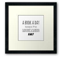A book a day keeps the Mundanes away Framed Print