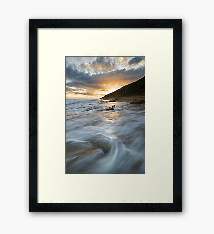 A Coy Sunset Framed Print