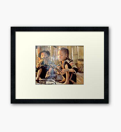 Girl lighting cheroot Framed Print