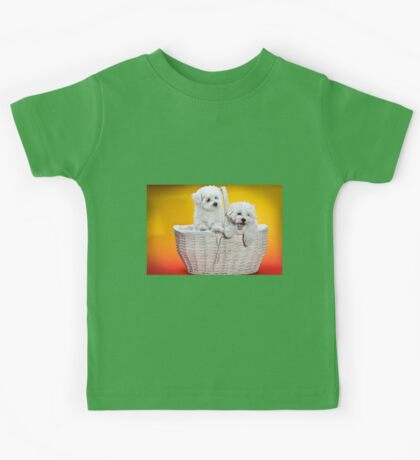 Two cute white puppies in white basket on orange and yellow background  Kids Tee