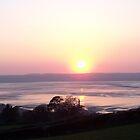 Sunset at Llanfairfechan. by Michael Haslam