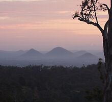 Sunrise over The Glasshouse Mountains by kerryedward
