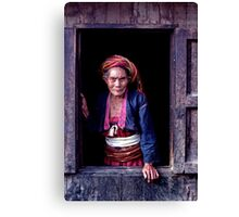 Woman at the window Canvas Print