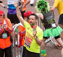 Richard Harrington crosses the finish line at the Virgin money London Marathon by Keith Larby