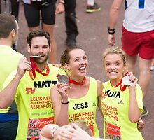 Matt, Jess and Laura collect their medals after crossing the finish line at the Virgin money London Marathon by Keith Larby