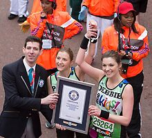 Three legged Runners collect a Guinness world record certificate at the finish line of the Virgin money London Marathon by Keith Larby
