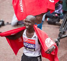 Wilson Kipsang crosses the finish line at the Virgin money London Marathon by Keith Larby