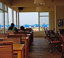 Early morning at a restaurant on Tel Aviv Beach by coralZ
