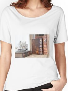 Old rare leatherbound books on a bookshelf Women's Relaxed Fit T-Shirt