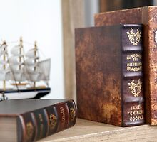 Old rare leatherbound books on a bookshelf by PhotoStock-Isra