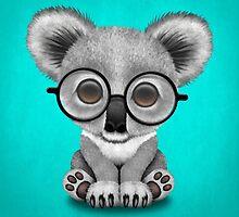 Cute Baby Koala Bear Cub Wearing Glasses on Blue by Jeff Bartels