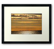 Golden sunset over the ocean Framed Print