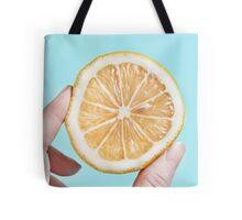 Juicy lemon on a blue background Tote Bag