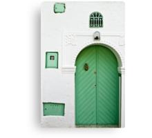Green Door, White Wall Canvas Print