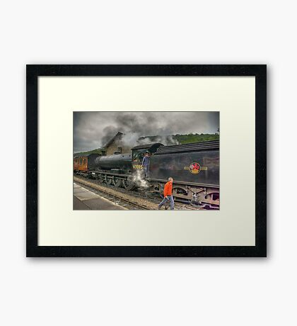 Checking The Line Framed Print