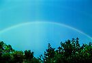 blue rainbow with faint second bow by Juilee  Pryor