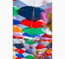 Colourful umbrellas strung up together on a blue sky background  Unisex T-Shirt