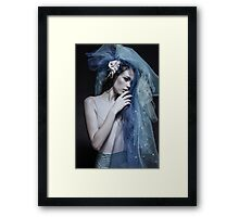 Atmospheric image of a veiled woman on black background  Framed Print