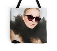 Woman with sunglasses submerged in water  Tote Bag