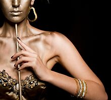 Woman in golden mask  by PhotoStock-Isra