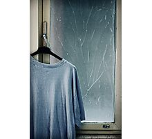 Hanging T-shirt and broken window pane Photographic Print