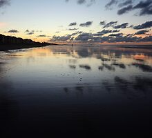 Clouds mirrored on wet beach by Jasperius