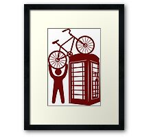Telephone booth box  with a man and s bike on a roof symbol  Framed Print