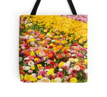 A field of multicolor cultivated Buttercup (Ranunculus) flowers  Tote Bag