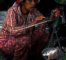 The Market's Fishes Lady - Phnom Penh, Cambodia. by Tiffany Lenoir