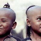 Happy tribal girls by John Spies