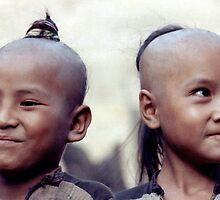 Happy tribal girls by John Spies
