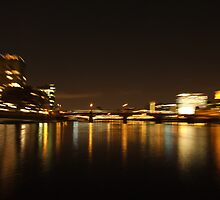Reflections on the River Thames at Night by pcimages