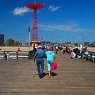 Coney Island strollers by Tom  Marriott