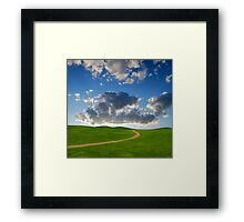 pedestrian path between green hills on a background picturesque sky Framed Print
