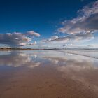 Washing the reflections at Saunton Sands by Zoe Power