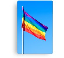 Gay rainbow flag with a blue sky background  Canvas Print