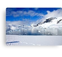 Icebergs and mountains of Cuverville Island near Antarctic Peninsula Canvas Print