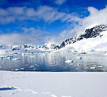 Icebergs and mountains of Cuverville Island near Antarctic Peninsula by PhotoStock-Isra