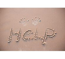 HELP written in the damp sand on a beach Photographic Print