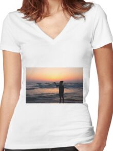 woman holds the sun as it sets in the palm of her hand  Women's Fitted V-Neck T-Shirt