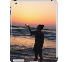 woman holds the sun as it sets in the palm of her hand  iPad Case/Skin