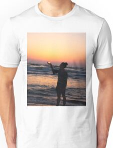 woman holds the sun as it sets in the palm of her hand  Unisex T-Shirt
