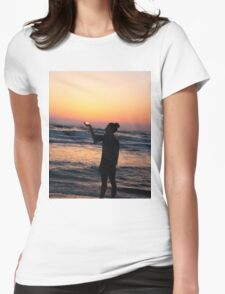 woman holds the sun as it sets in the palm of her hand  Womens Fitted T-Shirt