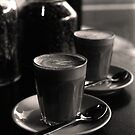 latte's at bekendales ( by the window - b&w film) by deborah brandon