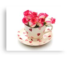 Roses in a cup Canvas Print