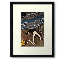 Female mechanic fixing stuff Framed Print