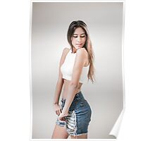 Young teen with long brown hair in jeans and white crop top Poster