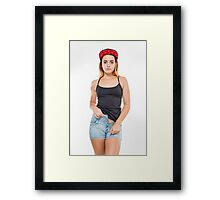 Playful female teen with red baseball cap wearing black top  Framed Print